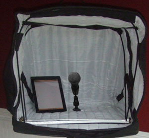 carry on vocal booth with mic and notebook