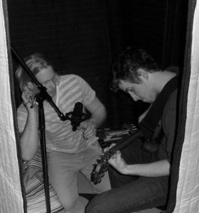 vocalboothtogo guitar-player-engineer-in-booth-466x500