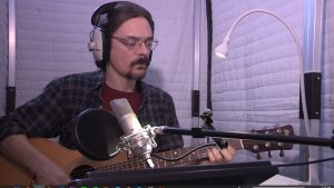 Guitar practice in Acoustic Vocal booth AVB63